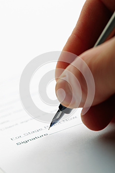 Man Holding A Pen While Doing Document. Royalty Free Stock Image - Image: 27101496