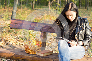 Woman On Park Bench Using A Tablet Stock Images - Image: 27169204