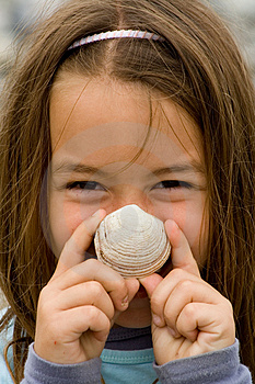 Happy Child with a SeaShell Free Stock Images