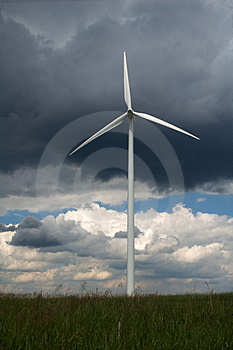 Windmill in green field Stock Photos