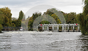 Weir And Sluice Gate On A Swollen River Thames Royalty Free Stock Images - Image: 27399319