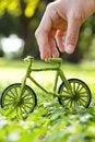 Hand Holding Eco Bicycle Stock Photo