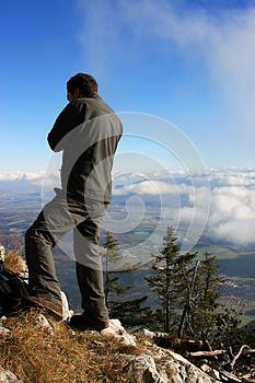 Man Admiring The View From The Top Of The Mountain Stock Photography - Image: 27545962