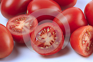 Group of sliced and whole tomatoes
