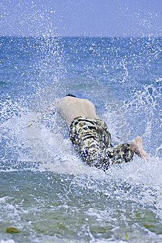 Young Man Jumping Into Sea Water Stock Photos - Image: 2903303