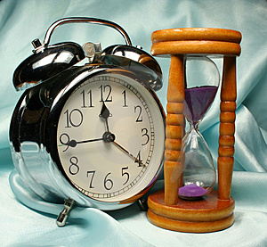 Alarm-clock And Sandglass On B Royalty Free Stock Photo - Image: 2938435