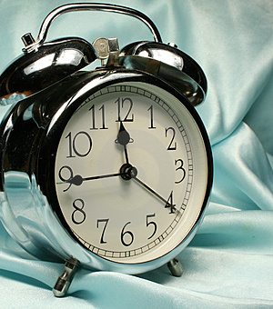 Alarm-clock On Blue Background Royalty Free Stock Photography - Image: 2938457