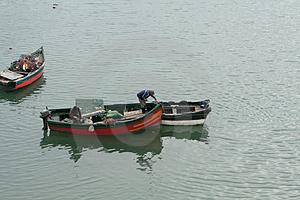 Fisher Works From Boat Royalty Free Stock Image - Image: 2950186
