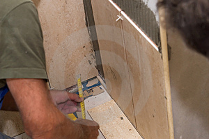 Tiles Installation On The Wall Stock Photos - Image: 2976713