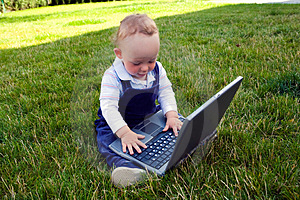 Baby study on computer Free Stock Image