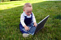 Baby study on computer Royalty Free Stock Image