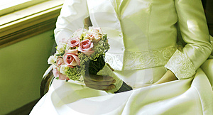 Flowers and her wedding dress Royalty Free Stock Image