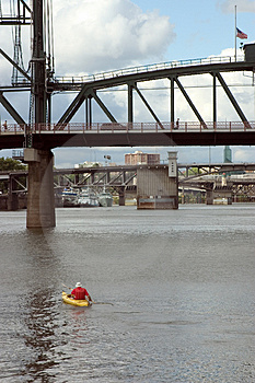 Man Kayaking Under Bridges Royalty Free Stock Photography - Image: 39397