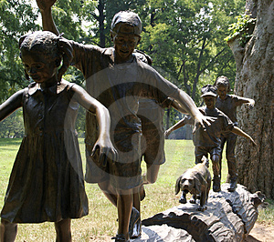 Statue of Children on Log Free Stock Photos