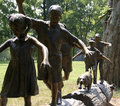 Statue of Children on Log
