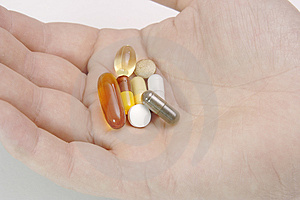 Hand full of pills and vitamin Stock Images