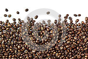 Coffee beans and coffee cup Stock Photos