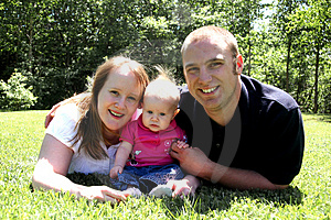 Young Family in Grass Royalty Free Stock Image