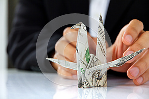 Business Man Hand Holding Origami Paper Cranes Royalty Free Stock Photos - Image: 30348678