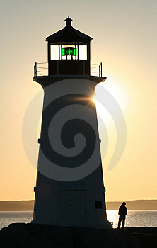 Young Man at Lighthouse Stock Photography