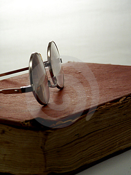 Glasses on book.