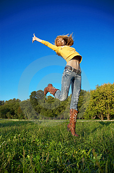 Blond girl jumping Stock Image