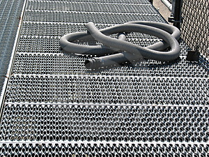 Gray Hose On Grating Stock Photography - Image: 3298272