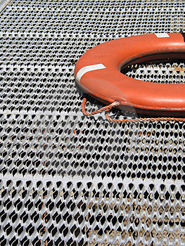 Orange Life Ring On Grating Stock Photos - Image: 3298293