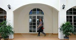 Man Walking Past Arches Royalty Free Stock Photos - Image: 334678