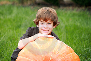 Boy And Large Pumpkin Royalty Free Stock Images - Image: 3305499