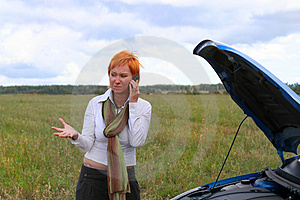 Young woman with broken car. Royalty Free Stock Image
