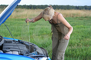 Woman with her broken car. Stock Photography
