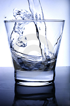 Water Poured Into Glass Royalty Free Stock Photos - Image: 3394118