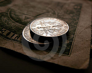 Two Dimes On A Dollar Bill Stock Photos - Image: 3404363