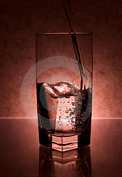 Liquid Being Poured Into Glass Stock Photo - Image: 3435000