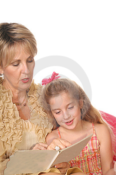 Grandmother reading to little Stock Photo