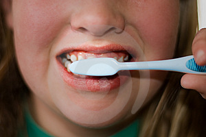 Older Child Brushing Teeth Free Stock Image