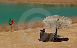 Sunshade And Lifering Royalty Free Stock Photo - Image: 3601745