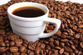 Cup coffee And coffee grain Stock Photos