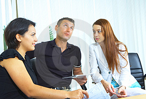 Three in the office Stock Image