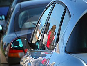 Reflections of people on cars