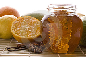 Fresh honey with honeycomb, spices and fruits Royalty Free Stock Photography