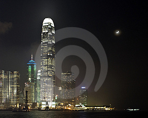 Hong Kong with Moon at Night Royalty Free Stock Photo