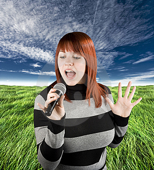 Redhead Girl Singing Karaoke On Microphone Royalty Free Stock Photography - Image: 3728617