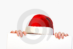 Christmas girl holding up a white sign for copyspa Royalty Free Stock Images