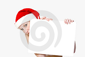 Christmas girl holding up a wh