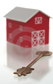 The red house and key from the house Stock Photos
