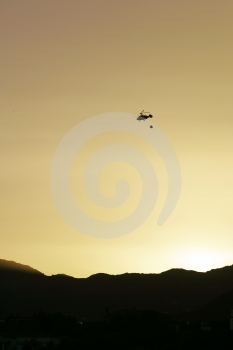Firefighter Helicopter Flying At Sunset Royalty Free Stock Photography - Image: 383037