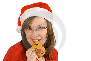 Santa Girl With Red Specs And Reindeer Gingerbread Royalty Free Stock Photos - Image: 3821708