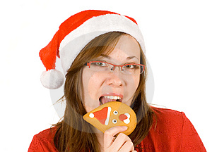 Santa Girl With Red Specs And Santa Gingerbread Royalty Free Stock Photography - Image: 3821747